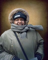 Lindsey (mckenziemedia) Tags: man streetwise salesman street streetphotography smile portrait portraiture face scarf winter hood coat gloves human humanity homeless homelessness