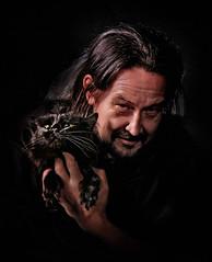 Self-portrait with Philip (my pet cat) (Anton_Letov) Tags: strobist portrait nikon cat lowkey smile