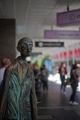 What am I doing here? (buberfan) Tags: voigtlandercolorultron melbourne statue bourkestreet shopping bokeh