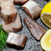 Fresh sea fish with lemon slices and dill