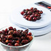 Dried rose hips in a glass bowl and on a kitchen scale