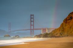 Golden Gate Bridge and Rainbow (optimalfocusphotography) Tags: usa landscape bridge nature mist longexposure sea northerncalifornia california sanfranciscobay rainbow sanfrancisco water fog beach ocean goldengatebridge waves