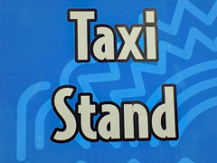 Taxi Stand Sign Macro. (dccradio) Tags: myrtlebeach sc southcarolina robesoncounty outdoor outdoors outside amusementpark park broadwayatthebeach pavilionpark pavilionparkcentral pavilionamusementpark pavilionamusementparkcentral nikon coolpix l340 bridgecamera sign words text color colorful taxistand blue white taxi