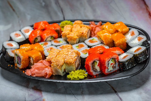 colorful Sushi Set nigiri and sushi rolls for two. Maki, scallop.