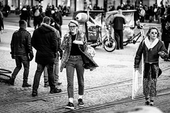the flamingo (Gerrit-Jan Visser) Tags: bewerkt streetphotography amsterdam damsquare blackandwhite bnw bird flamingo shopping girl trophy people citylife rare