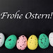Painted Easter eggs with Frohe Ostern text