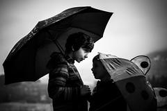 between me and you (-dubliner-) Tags: boys rain umbrella conversation talking youth blackandwhite monochrome portrait