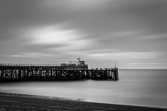 Passing by the Pier (Alex Crane MSc) Tags: beach pier longexposure 10stop landscape sea water clouds movement smooth blackandwhite moody seascape monochrome portsmouth hampshire morning overcast