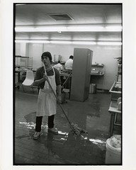 Student mopping cafeteria kitchen (Cambridge Room at the Cambridge Public Library) Tags: cambridgemass cambridge massachusetts bw blackandwhite olivepierce pierceolive cambridgerindgeandlatinschool crls