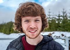 (dylanjamesbaumer) Tags: smile model sun panasonic oregon portrait 50mm 25mm beard snow