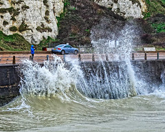 Risky Business (Croydon Clicker) Tags: wave storm water sea ocean photographer man wall car carpark cliff newhaven eastsussex