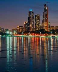 City Lights (BlinkOfALens) Tags: chicago reflection night bluehour skyline cityscape ice winter