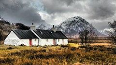 Black Rock on a winter's day. (Flyingpast) Tags: black rock cottage glencoe scotland mountain snow winter landscape buachailleetivemor munro scenic clouds storm weather highlands dramatic