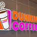 Shining neon advertising sign of the Dunkin' Coffee Logo in Barcelona, Spain