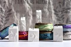 decisions, decisions... sari silk & botanical house pendants (Cherryhill Studio) Tags: etsy etsyseller naturalliving sarisilk colour color recycledsarisilk etsyhandmade womanmade ceramicjewellery ceramic clay botanicaljewellery botanicallife vintagebobbins bobbins creativelife creative