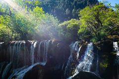Sunbeams on the Waterfall (Parker Vandermeer) Tags: 2017 asia china hiking jiuzhaigouvalley nationalpark nature nopeople r1 summer sun sunbeams sunny trees waterfall