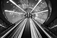 Subterranean Urban Beams (SUB) (awbaganz) Tags: warsaw underground subway metro warszawa poland polska bw monochrome stairs elevator beam light upstairs sony sonya7ii samyang24mm 24mm samyang easteurope europe architecture urban city