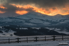 Flaming Winter Sunset (kevin-palmer) Tags: bighornmountains bighornnationalforest wyoming buffalo february winter cold snow evening sunset gold golden color colorful fence orange dartonpeak peakangeline clouds hospitalhill nikond750 nikon180mmf28 telephoto