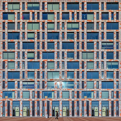 Freckled Geometry (Paul Brouns) Tags: architecture architectuur architektur amsterdam facade facades façades façade abstract abstraction abstractarchitecture abstrakt straightfacade square urbanpatterns urban tapestry tapestries windows paulbrouns paulbrounscom paul brouns colors spots spotted concrete piet hein kade woman passing stride by profile walking reflection sunliight sunny sunlit spring spot orange freckles freckled