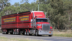 North on the Newell (1/6) (Jungle Jack Movements (ferroequinologist) all righ) Tags: thompson k200 toll nqx black clare freightliner mack trident richers timber de gunst bundaberg western star 4964 ks freighters scania parkes nsw new south wales sydney melbourne brisbane newell highway horsepower big rig haul freight cabover trucker drive transport lorry hgv wagon road semi trailer deliver cargo interstate articulated vehicle load freighter ship motor engine power teamster truck tractor prime mover diesel injected driver cab cabin beast wheel exhaust double b grunt australia australian