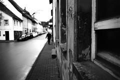 The road is a river (Leica M6) (stefankamert) Tags: film analog analogue leica m6 leicam6 voigtländer ultron kodak trix street man bokeh blackandwhite blackwhite noiretblanc noir road highcontrast blur blurry stefankamert window textures