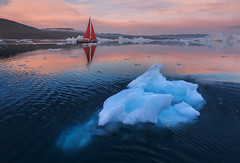 Red Sails in Greenland (Iurie Belegurschi www.iceland-photo-tours.com) Tags: adventure arctic aerialphotography aerialphoto beautiful birdseyeview blue cloudy clouds cold dreamscape dji djimavicpro2 earth enchanting fineart fineartlandscape fineartphotography fineartphotos guidedphotographyworkshops guidedphotographytour glacier icelandphototours iuriebelegurschi landscape landscapephotography landscapes landscapephotos landofthemidnightsun midnightsun nature outdoor outdoors ocean phototours phototour summer sky sunset seascape sea snowy snow snowcapped tours travel travelphotography view workshop workshops water greenland red redboat redsailboat redsails sailing iceberg icebergs