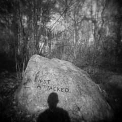 First Attacked #2 (LowerDarnley) Tags: holga dogtown gloucester ma capeann rock selfshadow firstattacked boulder glacial moraine inscription jamesmerry matador bull woods