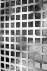 Trapped In A Box (belleshaw) Tags: blackandwhite saltonsea wall screen metal squares barrier detail texture abstract pattern grid mesh obsession cage