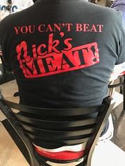 A Nick's devotee (LarryJay99 ) Tags: tshirt typography reds backs seated people