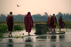 Walk On Water (Jeremiah Cooper Photography) Tags: nikon myanmar burma asia southeastasia travel travelphotography buddhistmonks monks youngmonks lake rivercrossing ubeinbridge water red white green gray amarapura