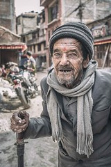 Listen to My Story... (Roberto Pazzi Photography) Tags: portrait people street eyes travel old man nepal face asia beard bhaktapur elderly elder culture place photography cap glance one person outdoor nikon half length cane