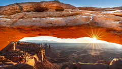 Sunrise at the Mesa Arch (Jaideep Mann) Tags: sunset sunrise canyonlands national park utah sun set rise sky clouds winter snow nps parks southwest south west colors canyon rocks mountains sunrays rays starburst