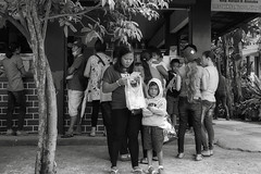 Checking (Beegee49) Tags: street– mother son boy child not happy filipina sony a6000 blackandwhite monochrome bw planet city philippines asia silay