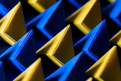 Bipyramids (benjaminjohnson1983) Tags: 2019 bipyramid blue craft geometric hobby lines macro macro2019 macromondays neewermacroledringflashlight origami paper papercraft row shadows triangle yellow folded