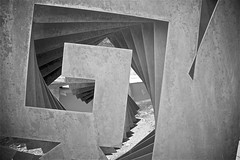 Detail of Steel Sculpture by Heloise Crista (sswj) Tags: detail sculpture steelsculpture oxidizedsteel heloisecrista taliesinwest franklloydwright scottsdale arizona composition monochrome blackandwhite bw availablelight existinglight nikon d600 nikkor28300mm dslr fullframe scottjohnson abstraction abstract abstractreality greys geometric triangles diagonals shadow reflectionoflight