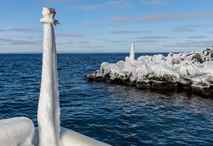 Iced Over (Karen_Chappell) Tags: ice icy weather winter cold bauline nfld newfoundland avalonpeninsula atlanticcanada atlantic ocean sea seascape canada water harbour blue white freezing frozen wharf rocks sky landscape clouds scenery scenic