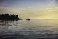 End of Day (jessicalowell20) Tags: atlanticocean black blue clouds cream island mainecoast obsterboat ocean silver sunset trees twilight workingwaterfront yellow