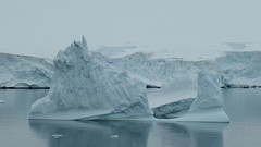 Iceberg on calm water, on the Antarctic Peninsula. (Ruby 2417) Tags: antarctica antarctic ice iceberg snow ocean sea coast coastline video gray fanciful summer