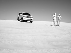 Capturing Dunes (Adventures in Infrared) (Torsten Reimer) Tags: olympusepl5 sand asia people wüste monochrome car auto blackandwhite photographer arabia infrared desert katar himmel sky sanddune schwarzweis infrarot qatar men alwakrahmunicipality qa
