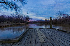 Sunset by the Pier on a Cloudy Day (SweetCreek) Tags: sunset lake sky pink over river landscape sunrise water evening orange reflection nature horizon summer beautiful colorful blue beauty color dusk background light trees tranquil pier fishing cloudy