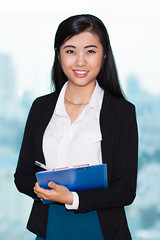 Closeup of Fascinating Asian Woman with Clipboard (nguyentuyetanh) Tags: person single female woman young adult middleaged asian lady girl hair black brunette formal blouse jacket clipboard pen conducting survey interview standing writing looking camera working smiling calm content confident friendly manager secretary student businesswoman successful office company professional smart business beautiful fascinating attractive elegant stylish questionnaire background closeup