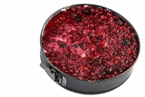 Round Raspberry Cheese Cake above white background