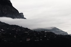 Mystical (N.Hell) Tags: mountain landscape cityscape contrast dark darkness mystical cloud smoke light bright village desaturated forest tree atmosphere mood bad weather