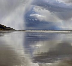 Into my Arms (pauldunn52) Tags: clouds shower storm blue witches point wales glamorgan heritage coast reflection wet sand