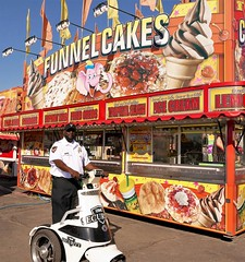 TO PROTECT AND TO SERVE (Rob Patzke) Tags: carnival security ride funnel food cart vendor uniform scooter panasonic lx100 lumix
