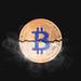 Bitcoin broken in half with smoke