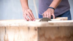 Asian Carpenter using circular saw for cutting wooden planks (SawAdvisor) Tags: circular saw woodworking carpenter cutting circularsaw