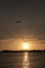 Trying to Catch a Big One (Fletch in HI) Tags: nikon d5600 tamron 16300 pearlharbor hickamafb hawaii oahu ocean sunset sky water people plane clouds