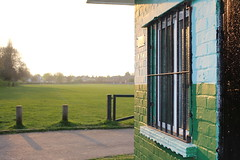 St Georges Park,2 (doojohn701) Tags: building toilet bollards gate barrier green grass blue paint grille windows black door sunlight sky trees vegetation shadow sunset reflection sidcup uk park