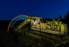 Digging for gold (Eifeltopia) Tags: südeifel bagger old rusty excavator lightpainting bluehour lichtmalerei regenbogen rainbow idea demag raupenbagger baumaschine machines digging lostplace schönheitsfehler lichterkette